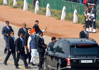 India's Prime Minister Narendra Modi waves to the crowd after attending Republic Day parade in New Delhi
