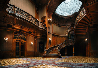 House of Scientists. Interior of the magnificent mansion with ornate grand wooden staircase in the great hall. A former national casino.