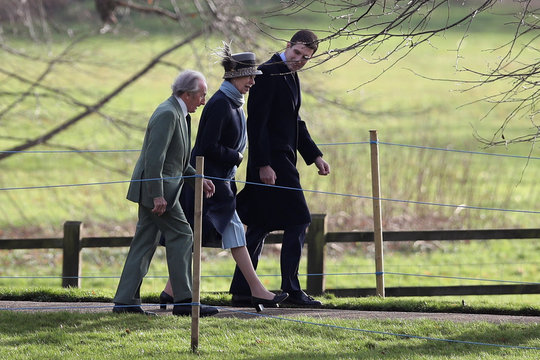 Britain's Princess Anne and former Formula One racing driver Jackie Stewart arrive at St Mary Magdalene's church on the Sandringham estate in eastern England
