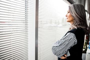 Fototapeta Calm woman in front of the window stock photo obraz