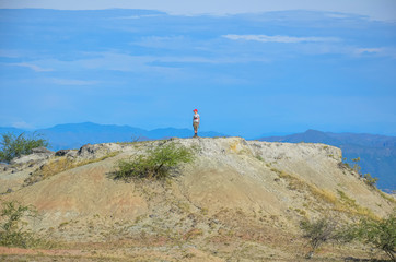 boy on a hill in the Tatacoa desert in Colombia