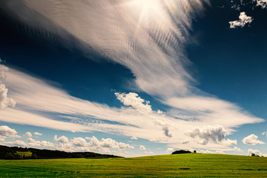 Field with Beautiful Clouds on Big Blue Sky Wide Angle View