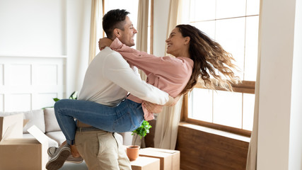 Overjoyed young couple have fun on moving day