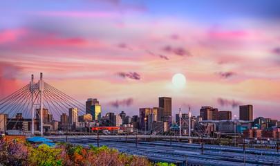 Zelfklevend Fotobehang Afrika Johannesburg city skyline and Nelson Mandela bridge at sunset