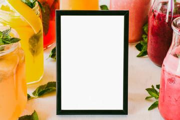 Detox cocktail assortment. Organic homemade lemonade. White menu mockup in picture frame.