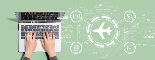 Flight ticket booking concept with person using a laptop computer