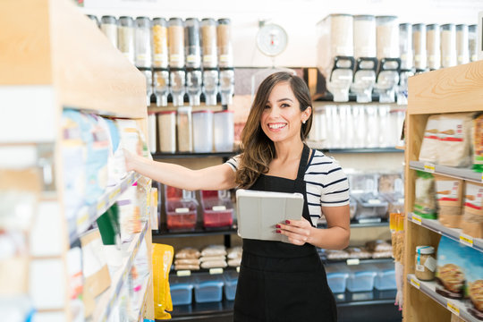 Saleswoman Checking Food Inventory In Store