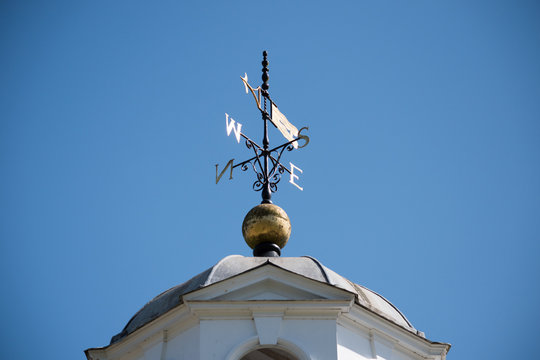 Low Angle View Of Weather Vane On Tower Against Clear Blue Sky