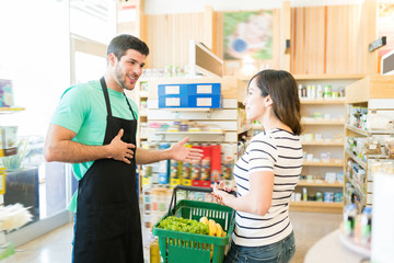 Smiling Owner With Buyer In Grocery Store