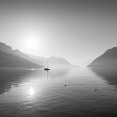 Landscape with mountains and a lake in black and white. - 318271624