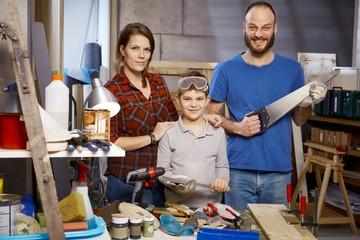 Portrait of tinkering family