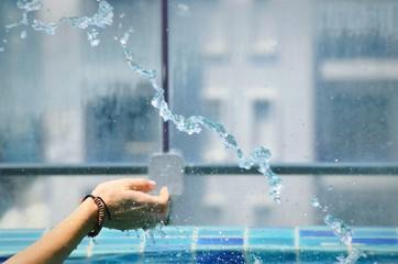 Cropped Image Of Woman Splashing Water At Swimming Pool