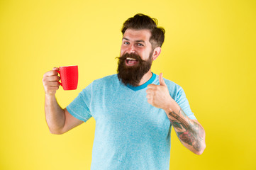 starting day with good drink. good morning coffee. Water balance and health care. Bearded man enjoy morning routine. sip of inspiration. hot drink mug. man casual style drink tea