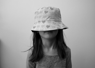 Girl Wearing Hat Against Wall At Home