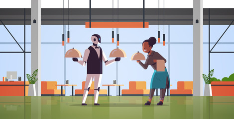 Wall Mural - robotic waiter with waitress holding tray with dish robot vs human standing together artificial intelligence technology food serving concept modern restaurant interior full length horizontal vector