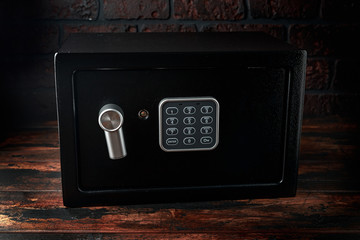 Steel Safe, Safety box or modern electronic locker on wooden background
