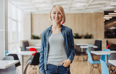 Cheerful woman in modern cafeteria