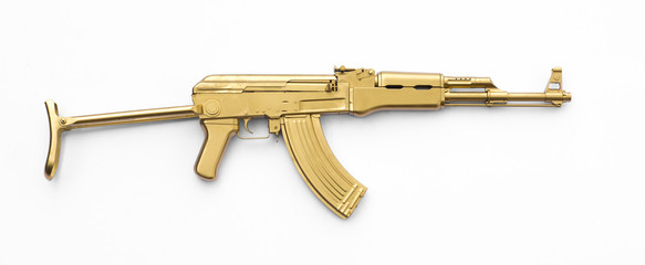 golden AK-47 assault rifle isolated on white background