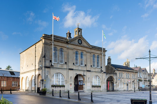Melksham Town Hall against a blue winter sky with flags flying on a sunny winter late afternoon
