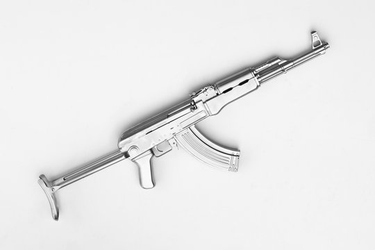 silver AK-47 assault rifle isolated on white background
