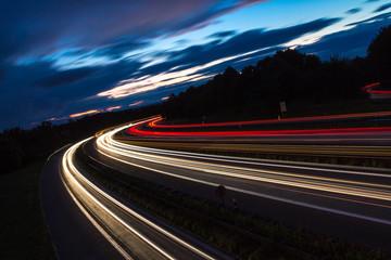LIGHT TRAILS ON ROAD AGAINST SKY AT NIGHT Fototapete