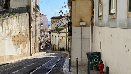 Typical winding street view in Alfama, Lisbon