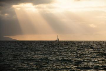 Wall Mural - Sailboat Silhouette Ocean Sun Rays