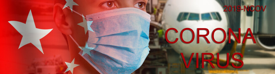 The phrase Corona virus on a banner with blurred Chinese flag and plane on the background.