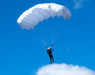 Humorous picture - a skydiver standing on a cloud.