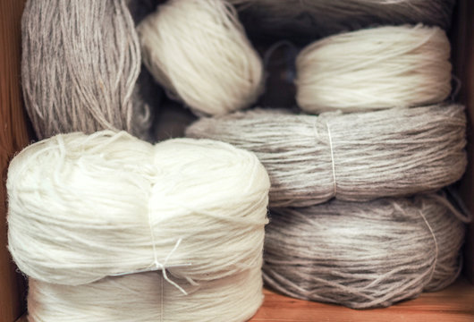 skeins of white and gray wool on the shelf in the store. the concept of zero waste