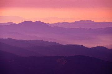 purple sunset in the mountains Fotomurales