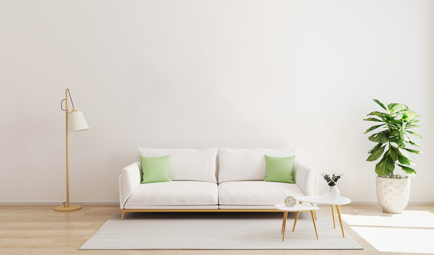 Living room interior with white sofa and green pillows, modern coffe table, floor lamp, plant and rug on wooden floor and white wall. Living room interior mockup. Scandinavian style, bright. 3d render