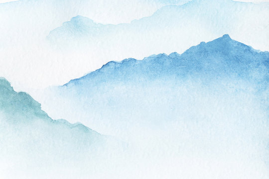 Hand drawn watercolor painting of blue foggy mountains