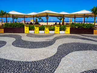 Fotobehang - Copacabana beach with mosaic of sidewalk and kiosks in Rio de Janeiro, Brazil. Copacabana beach is the most famous beach in Rio de Janeiro. Sunny cityscape of Rio de Janeiro