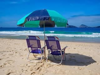 Fotomurales - Beach chairs and umbrella on beach in Rio de Janeiro.