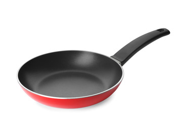Modern red frying pan isolated on white