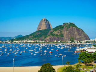 The mountain Sugarloaf and Botafogo beach in Rio de Janeiro, Brazil. Sugarloaf is one of the main landmark of Rio de Janeiro. Cityscape of Rio de Janeiro