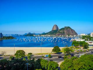 Fotobehang - The mountain Sugarloaf and Botafogo beach in Rio de Janeiro, Brazil. Sugarloaf is one of the main landmark of Rio de Janeiro. Cityscape of Rio de Janeiro