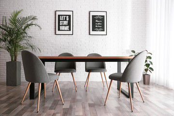 Modern dining room interior with stylish furniture