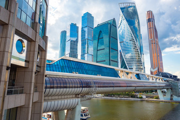 Moskva-city. Skyscrapers of glass and concrete. Glazed bridge over the river Moscow. Business card of the capital of Russia. Modern urban architecture. Downtown.