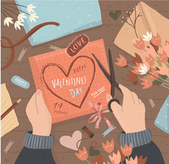 Happy Valentine's day! Cute vector illustration of creating and cutting a valentine`s day postcard from paper at a table with an envelope and flowers. hand drawing with scissors