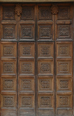 Elaborate carved wooden doors of Cathedral of St Catherine