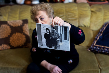 Jona Laks, survivor of Dr. Josef Mengele's twins experiments shows a photo of her and her older sister Chana, during an interview in her house in Tel Aviv