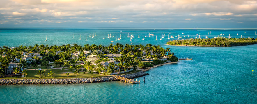 Panoramic sunrise landscape view of the small Islands Sunset Key and Wisteria Island of the Island of Key West, Florida Keys.