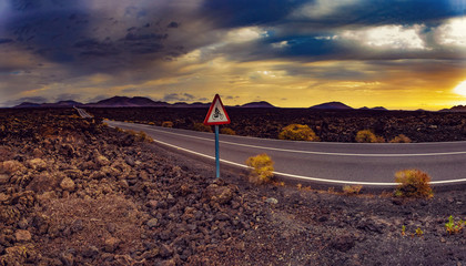 Zelfklevend Fotobehang Diepbruine Image related to unexplored road journeys and adventures.Road through the scenic landscape to the destination in Timanfaya natural park in Lanzarote,Canary island,Spain