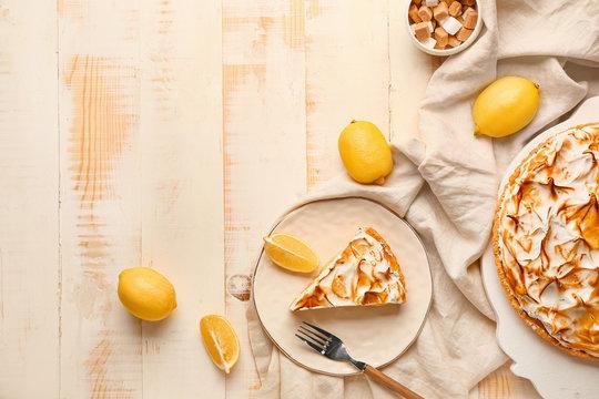 Tasty lemon pie on wooden table