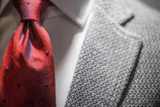 Midsection Of Man Wearing Suit And Necktie
