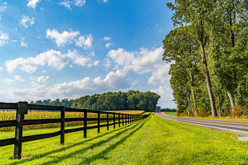 Amish country field agriculture, beautiful brown wooden fence, farm, barn in Lancaster, PA US