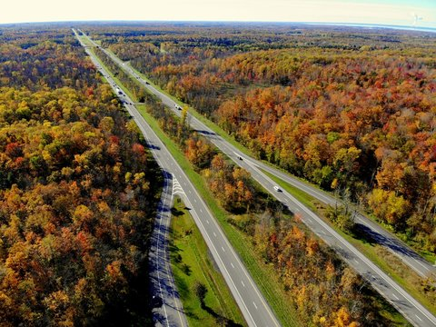 The aerial view of stunning fall foliage near Interstate 81 highway of Watertown, New York, U.S.A