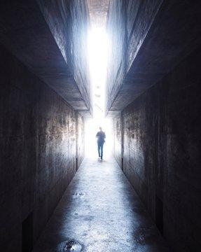 Full Length Of Man Walking In Tunnel